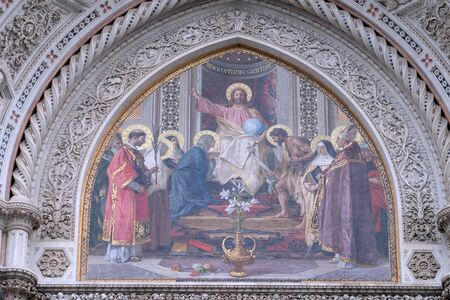Christ Enthroned with Mary and St. John the Baptist Main Portal of Cattedrale di Santa Maria del Fiore (Cathedral of Saint Mary of the Flower), Florence, Italy Stock Photo