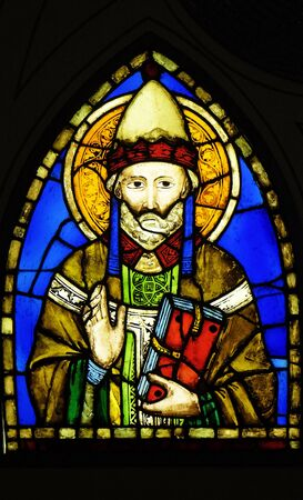 Saint Pope stained glass window by Pacino di Buonaguida (1280–1340) in the Basilica di Santa Croce (Basilica of the Holy Cross) - famous Franciscan church in Florence, Italy