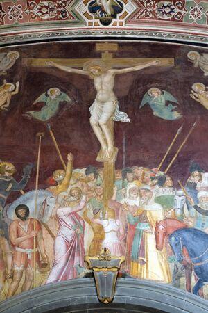 The Crucifixion, fresco by Andrea Di Bonaiuto, Spanish Chapel in Santa Maria Novella Principal Dominican church in Florence, Italy Фото со стока