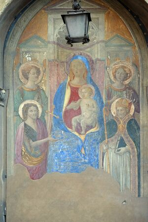 Madonna Enthroned with Saints and Angels, fresco by Francesco Fiorentino, corner of Via della Scala and Piazza Santa Maria Novella in 1420, in Florence, Italy