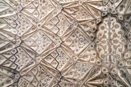 Red Fort stone carving pattern detail in Agra. Uttar Pradesh, India.