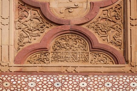 Beautiful stone carvings on the wall in Fatehpur Sikri complex, Uttar Pradesh, India