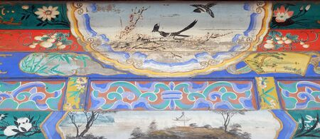 Ornate painted ceiling on a building in the Forbidden City in Beijing, China