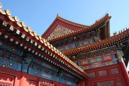 Tiled roof and facade decorated with a Chinese pattern. Palace in The Forbidden City, Beijing, China.