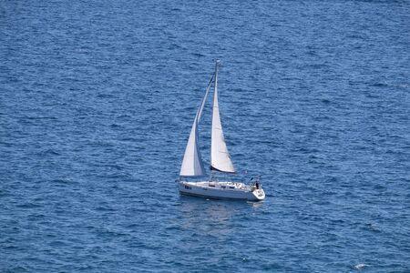 White sailboat on open blue sea in Portoroz, Slovenia