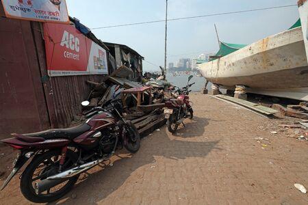 Motor cycle parked at Colaba Fishing Village, southern end of Mumbai city, India