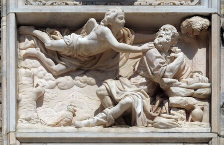 Elijah in the Wilderness, marble relief on the facade of the Milan Cathedral, Duomo di Santa Maria Nascente, Milan, Lombardy, Italy
