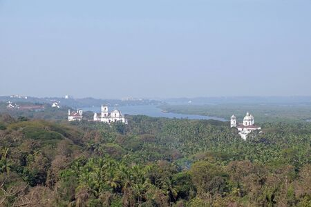 Old Goa along Mandovi River with Se Cathedral in front of Church of St Francis of Assisi, left, and Church of St Cajetan, right, Goa, India