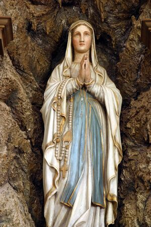 Our Lady of Lourdes statue in the church of St. Mary Magdalene in Veliki Bisag, Croatia
