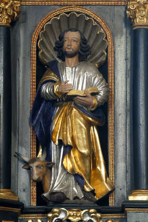 Saint Luke the Evangelist, statue on the pulpit in the Church of Saint Catherine of Alexandria in Zagreb, Croatia