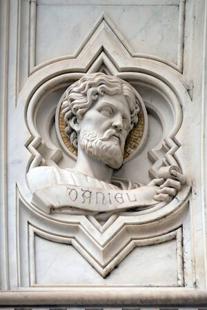 Daniel, relief on the facade of Basilica of Santa Croce (Basilica of the Holy Cross) - famous Franciscan church in Florence, Italy