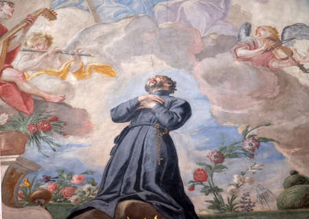 St. Francis kneeling on a cloud surrounded by music making angels, fresco on the ceiling of the Jesuit church of St. Francis Xavier in Lucerne, Switzerland