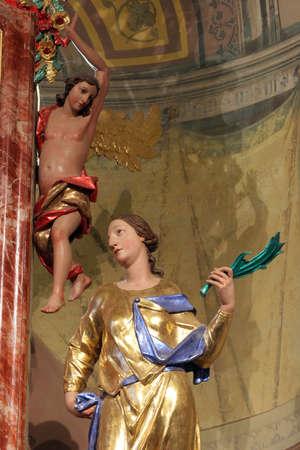 Saint Crescentia, statue on the main altar in Saints Vitus church in Ozalj, Croatia
