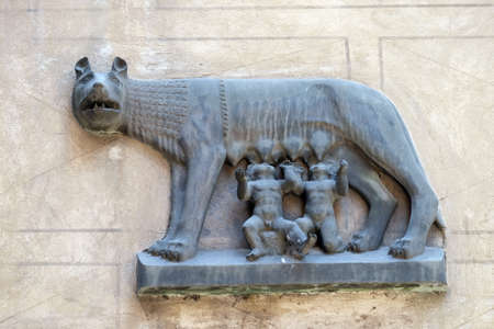 Replica of Capitoline Wolf (Lupa Capitolina) depicting a she-wolf suckling twin human infants, Romulus and Remus, the legendary founders of Rome, bas-relief in Verona.
