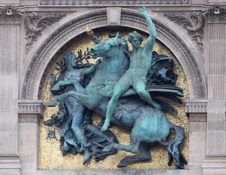 Genius of the Arts Astride Pegasus by Marius Jean Antonin Mercie, architectural detail of the Louvre Museum, one of major landmark in Paris, France