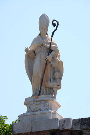 Saint Paulinus of Antioch, first Bishop of Lucca from the medieval wall that surrounds the city of Lucca in Tuscany, Italy