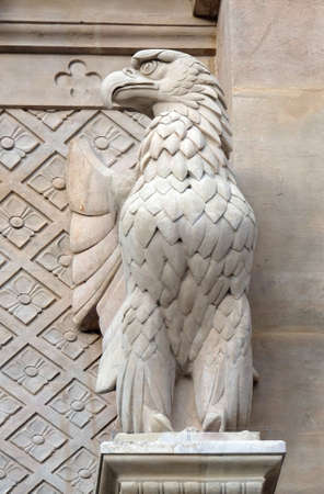 The eagle symbol of St. John the Evangelist, statue on the facade of Saint Augustine church in Paris, France Reklamní fotografie