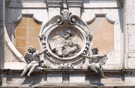 Saint Luke the Evangelist, statue on facade of the Mantua Cathedral dedicated to Saint Peter, Mantua, Italy