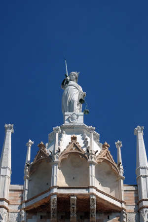 Goddess of Justice, statue at the top of Doge Palace in Venice, holding balance scales and sword, erected in 1579, Venice, Italy