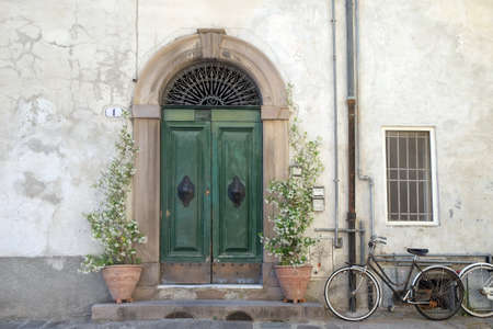 Residential doorway detail from the medieval town Lucca, Tuscany, Italy
