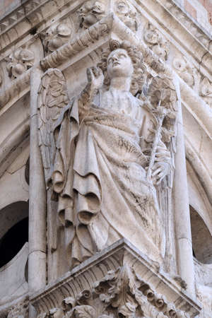 Sculpture of Archangel Gabriel, detail of the Doge Palace, St. Mark Square, Venice, Italy