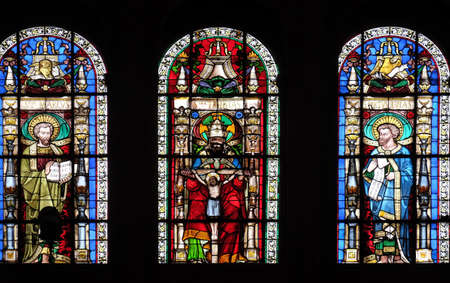 Holy Trinity between Saints Mark and Luke, stained glass window in Saint-Eustache church in Paris, France