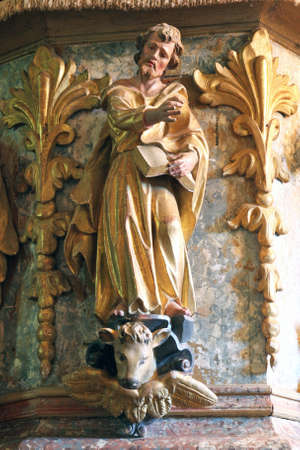 St. Luke the Evangelist statue at the pulpit in the Church of the Assumption of the Virgin Mary in Taborsko, Croatia