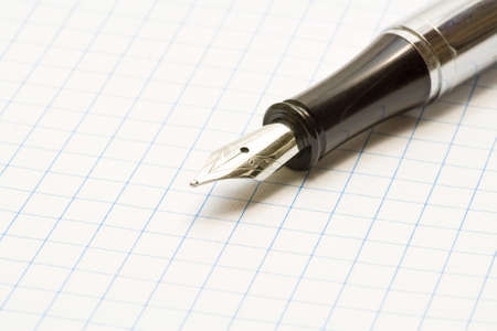 A stylish fountain pen is on paper