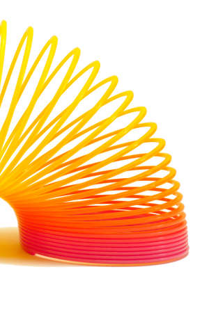 Part of slinky toy on white background Stock Photo