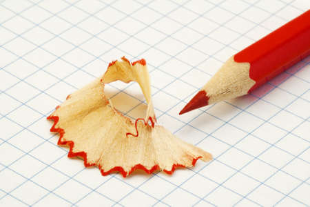 Red pencil shavings on a piece of paper Stock Photo