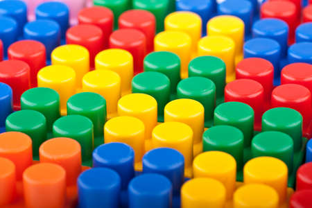 In the picture a bunch of colored plastic blocks Stock Photo