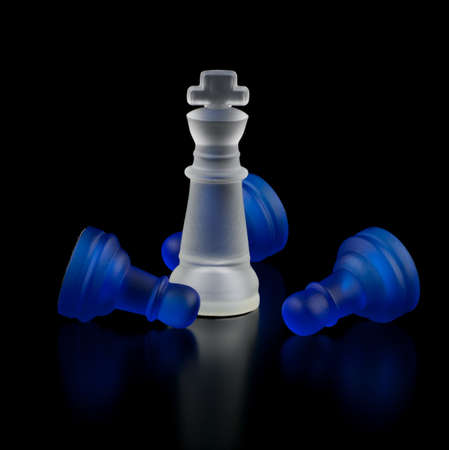 The success of the white king. Chess on a black background.