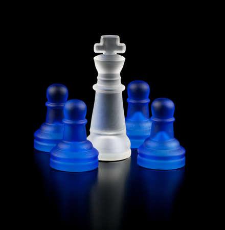 White captive king  Chess on a black background  Stock Photo
