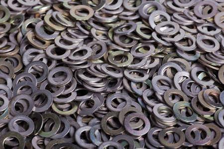 A pile of flat metal shims Stock Photo