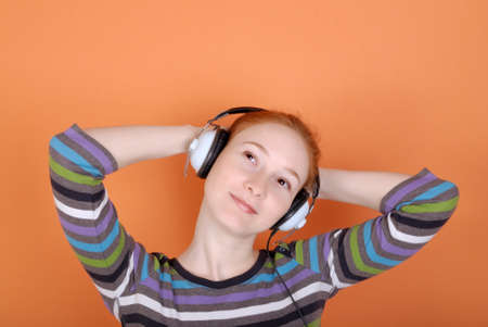 The woman in headphones with copy space