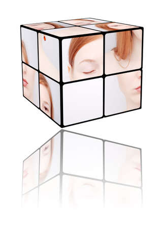 Portrait of the girl in a Rubics cube on a white background