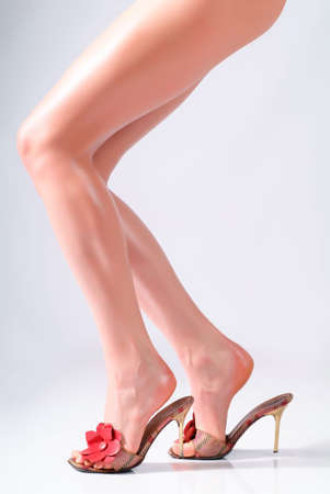Womans feet in sandals on the heels Stock Photo