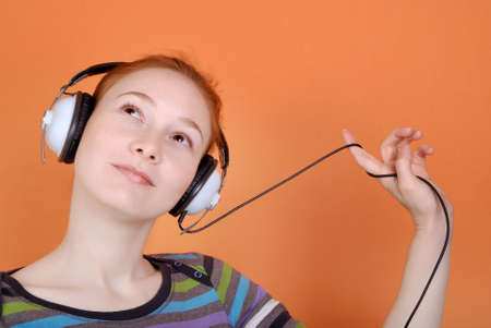 Redhead young woman in headphones with copy space Stock Photo