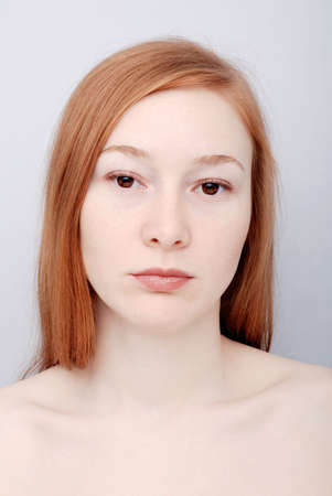Portrait of the redhead young woman