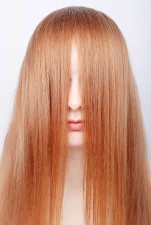 Portrait of the redhead young woman with long hair Stock Photo