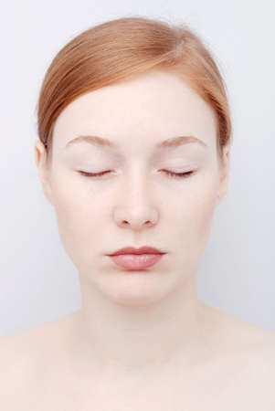 Portrait of the redhead young woman with his eyes closed Stock Photo