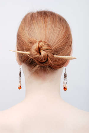Portrait of the redhead young woman from behind Stock Photo