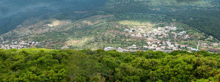 Panorama of green mountains on a summer day Stock Photo