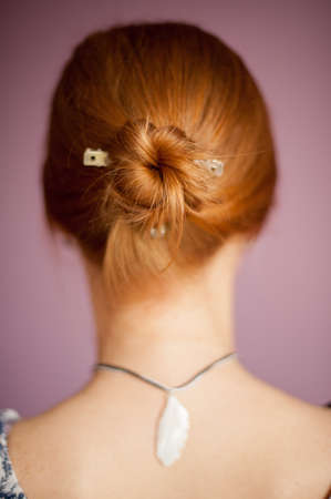 Hairstyle in a ponytail red-haired woman Stock Photo