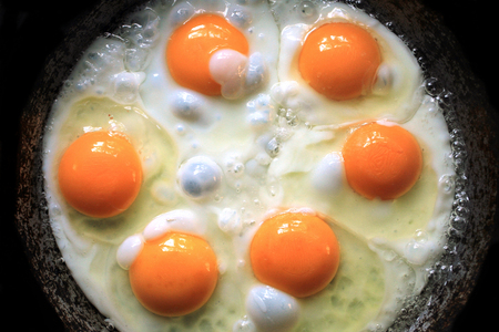 fried egg: Fried eggs fried eggs from 6 eggs fried in a pan Stock Photo