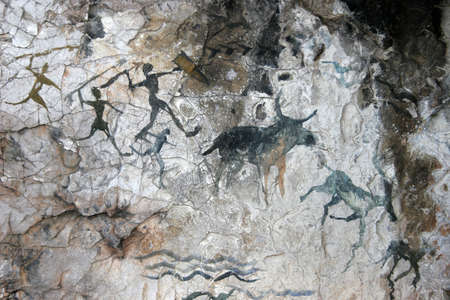cave paintings of primitive people. imitation Stock Photo