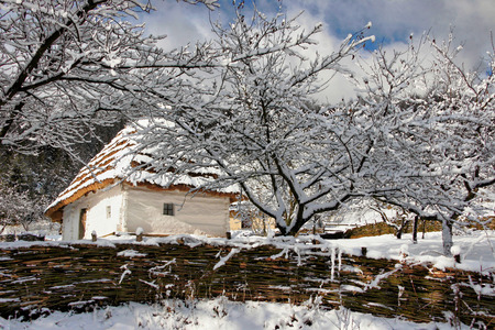 sylvan: Fairy-tale winter authentic house with whitewashed walls of woven fence Stock Photo