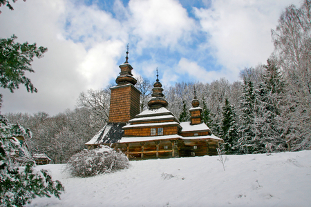 slavonic: Old Church Slavonic Orthodox church in the snow, with three crosses on the domes. Covered with wooden shingles. Stock Photo