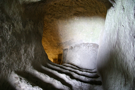 underworld: Steps carved in limestone lead to the cave town Stock Photo