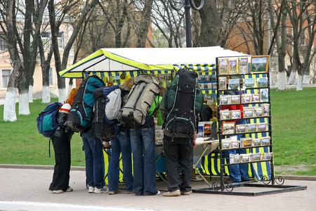 Ukraine City Kamenetz-Podolsk, 22.04: 2015. Tourists hiking backpacks gathered around the shop with souvenirs Editorial